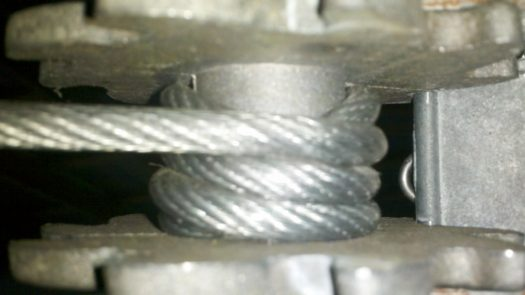 Wrap the Cable onto the Cable Tightener by the Inline Spacer at the Beginning of the Clothesline with the Small Pulley